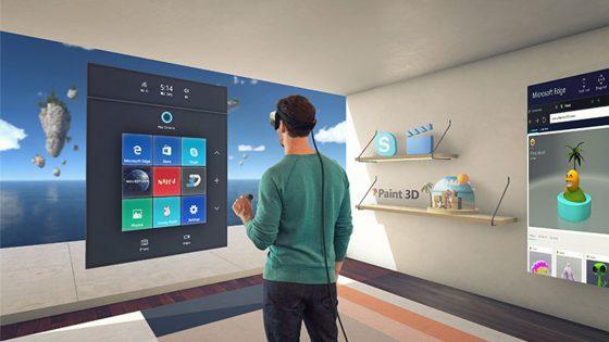 Mann steht im Raum vor Windows-10-Schaltfläche und