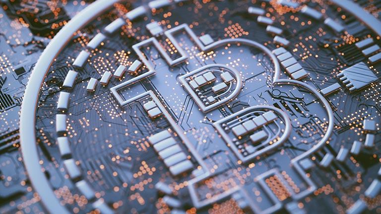 Computergrafik des Bitcoin-Logos auf einer Platine.